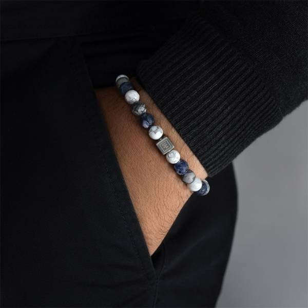 Blue Beaded Stretch Bracelet on mans hand